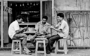 Men Playing Cards In The Storefront