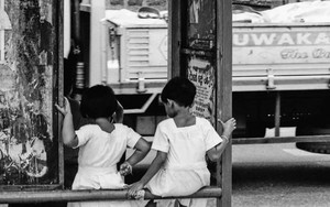 Two Little Girls At A Bus Stop