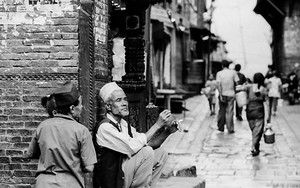 Two Men In The Corner Of The Street