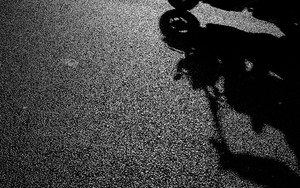 Silhouette And Shadow Of A Motorbike