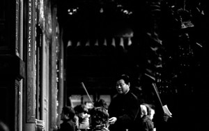 Woman Kneeling In Longshan Temple