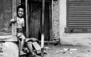 Boy Smiled Beside A Wooden Pillar