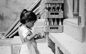Little Girl Standing In Front Of A General Store