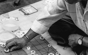 Man Playing Xiangqi On The Ground