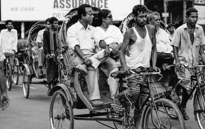 Couple Sitting On A Cycle Rickshaw