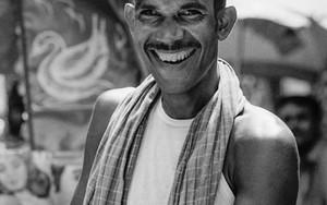 Smile Of A Rickshaw Wallah Wearing A Cap