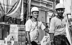 Two Construction Workers Wearing Helmet