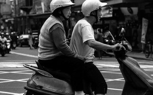 Old Couple Riding A Motorbike