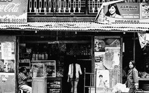 Long-haired Woman Stepping Inside A Store