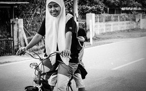 Two Girls Wearing Hijab On The Bicycle