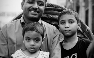 Father And His Two Sons On A Cycle Rickshaw