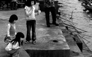 Three Girls Playing Near Water