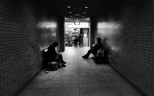 Two Persons Sitting In The Passageway