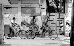 Cycle Rickshaw And Inclined Power Pole