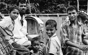 Men And Boys Around A Cycle Rickshaw