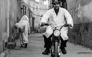 Helmet And White Coat In The Lane