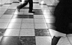 Pedestrians Walking In A Brisk Pace