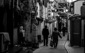 Few People Walking The Narrow Street