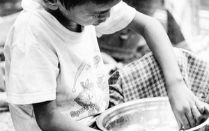 Boy Holding A Bowl