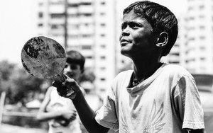 Boy Holding A Racket