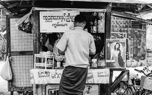 Man Buying At A Kiosk