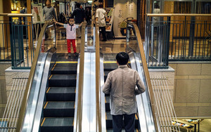 Boy And Escalator