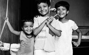 Amused Smiles Of Three Kids
