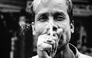 Cigarette In Font Of His Face