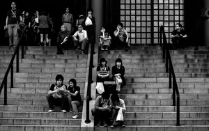 People Resting On The Staircase