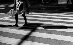 Woman Walking The Pedestrian Crossing