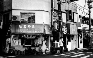 Young Man Beside A Takoyaki Shop