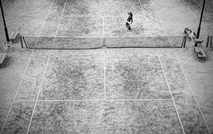 Woman In A Tennis Court
