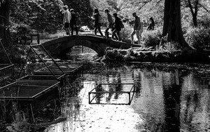 People On The Small Stone Bridge