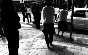 Standing People At A Crossing