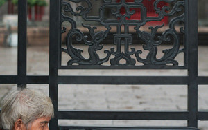 Woman Beside The Gate