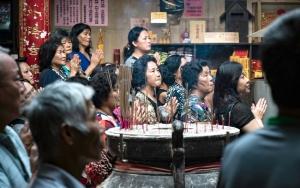 Praying People And Incense Burner