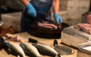 Heads Of Fish And Fishmonger