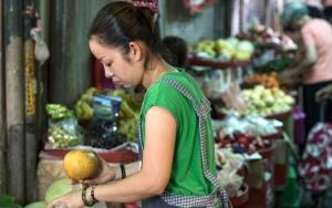 Woman Holding A Pomelo