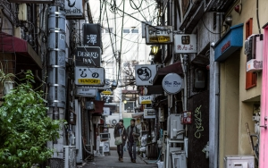Many Signboards In Alleyway