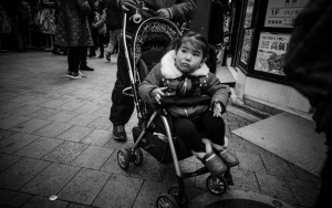 Little Girl On A Baby Buggy
