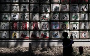 Silhouette In Front Of Sake Barrels