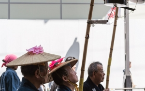 Man Holding A Long Pole