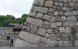 Man Beside Stone Wall