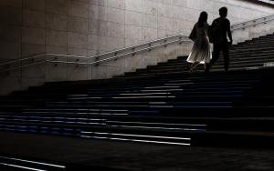 Couple Climbing Stairway