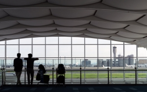 Two Silhouettes In The Terminal
