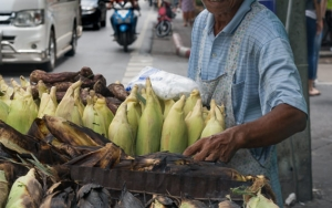 Man Selling Grilled Corns