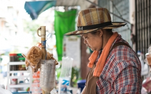 Hatted Woman In A Food Stall