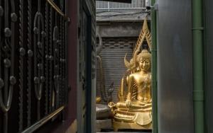 Buddha Statue At End Of Lane