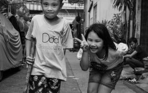 Two Kids Playing In Lane