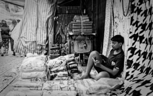 Man Selling Bedclothes